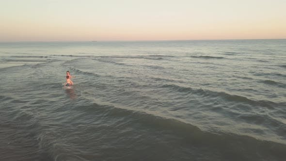 Thumbnail for Young Sister and Brother Who Are Playing in the Sea