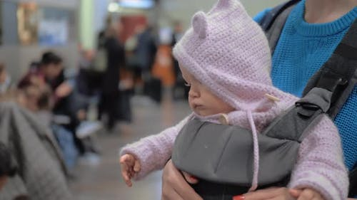 Mum with Baby Daughter in Kangaroo Carrier at the Airport