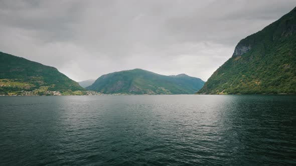 Thumbnail for View From the First Person Sailing Along the Beautiful Fjords in Norway. High Cliffs Off the Coast