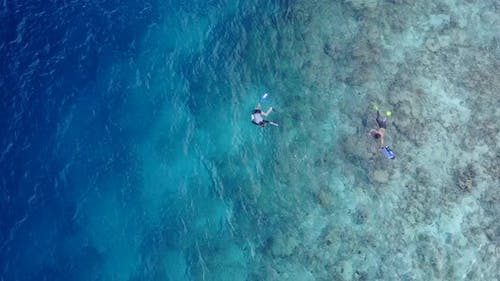 Happy couple on romantic honeymoon enjoy luxury on beach on sunny white sandy background