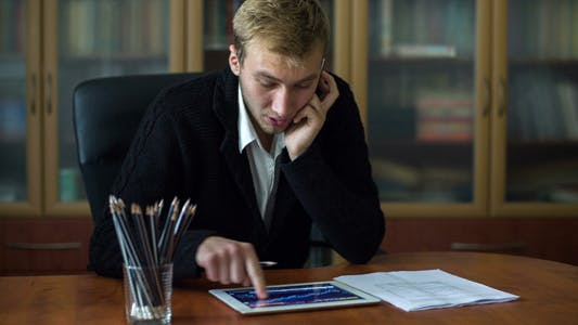 Cover Image for Businessman On The Phone While Working 1