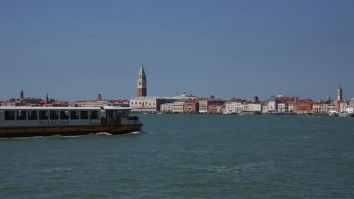 Boats Passing Venice Lagoon with a Magical St