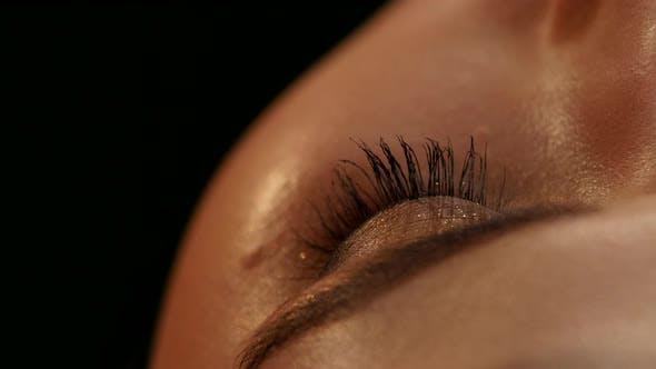 Thumbnail for Makeup Artist Applying Mascara. Black. Closeup