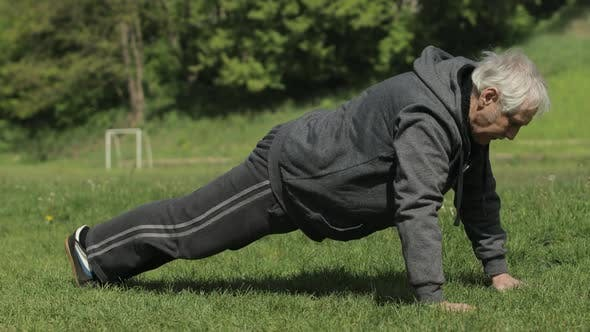 Thumbnail for Active Senior Old Man Do Push-ups Physical Exercises in Sport Playground