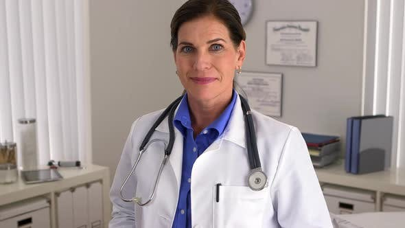 Senior doctor standing in office