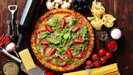 Thumbnail for Italian Food Background with Pizza, Raw Pasta and Vegetables on Wooden Table