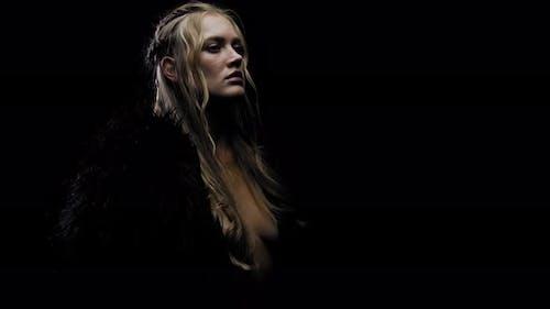 Blonde Medieval Princess in a Black Fur Coat Is Taking a Deep Breath