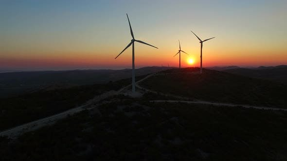 Thumbnail for Aerial view of windmills at beautiful colorful sunset
