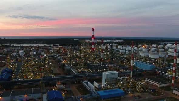 Aerial view of the petrochemical oil refinery plant shines at night
