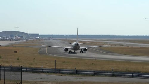 Passenger Plane Taxiing to the Runway
