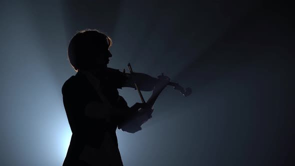 Thumbnail for Violinist Plays a Lyrical Work. Black Smoke Background. Close Up. Silhouette