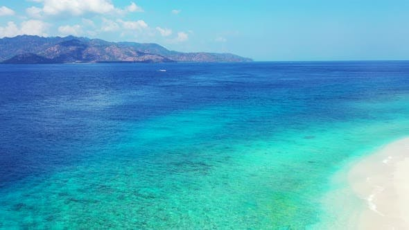 Thumbnail for Beautiful flying clean view of a white sandy paradise beach and aqua blue water background in colorf