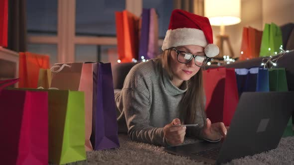 Happy Woman Glasses Wearing Santa Claus Hat Is Lying Carpet Makes Online Purchase Using Credit Card