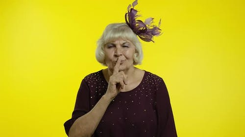 Senior Old Woman Zipping Lips and Looking Scared, Covering Mouth Promising To Keep Secret, Silence