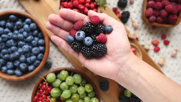 Thumbnail for Female Hand Holding Fresh Berries For Healthy Life. Antioxidant Super Foods.