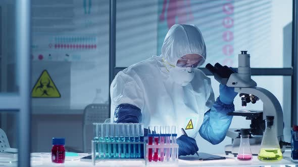 Thumbnail for Professional Virologist Using Microscope and Taking Notes in Lab