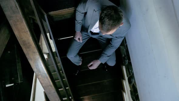 Man in a Suit on the Stairs
