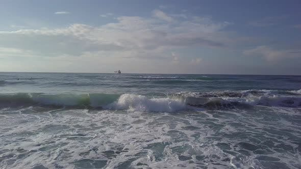 Thumbnail for Aerial Sliding Trough Stormy Waves To Sea Tanker at Horizon