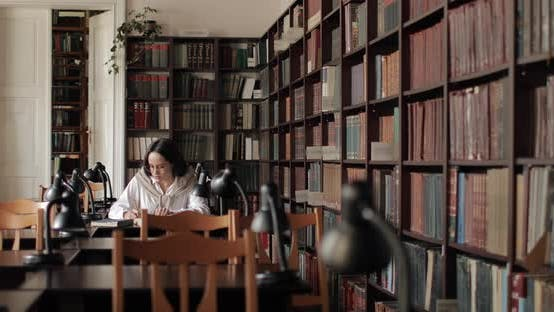Thumbnail for Wide Shot of Girl Studying in Library