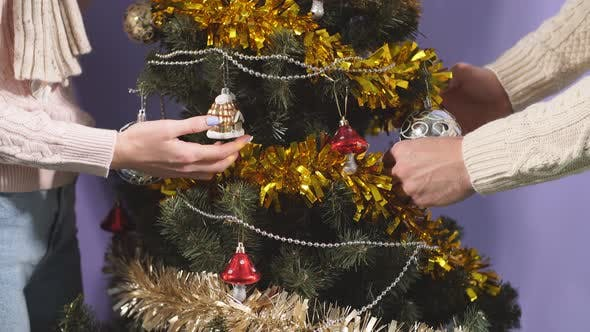 Close Up of Young Couple Happy To Have Decorated Christmas Tree at Home