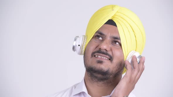 Cover Image for Face of Happy Indian Sikh Businessman Listening To Music