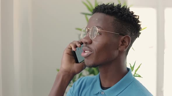 Thumbnail for Handsome African-american Young Man Talking with Smartphone.