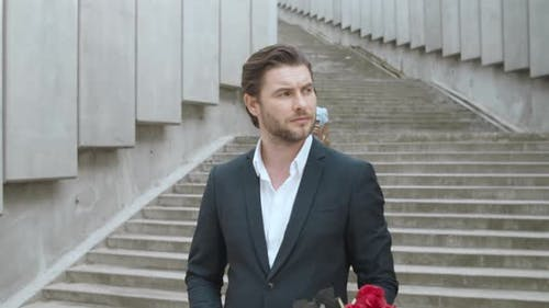 Boyfriend with Flowers Waiting for Girlfriend