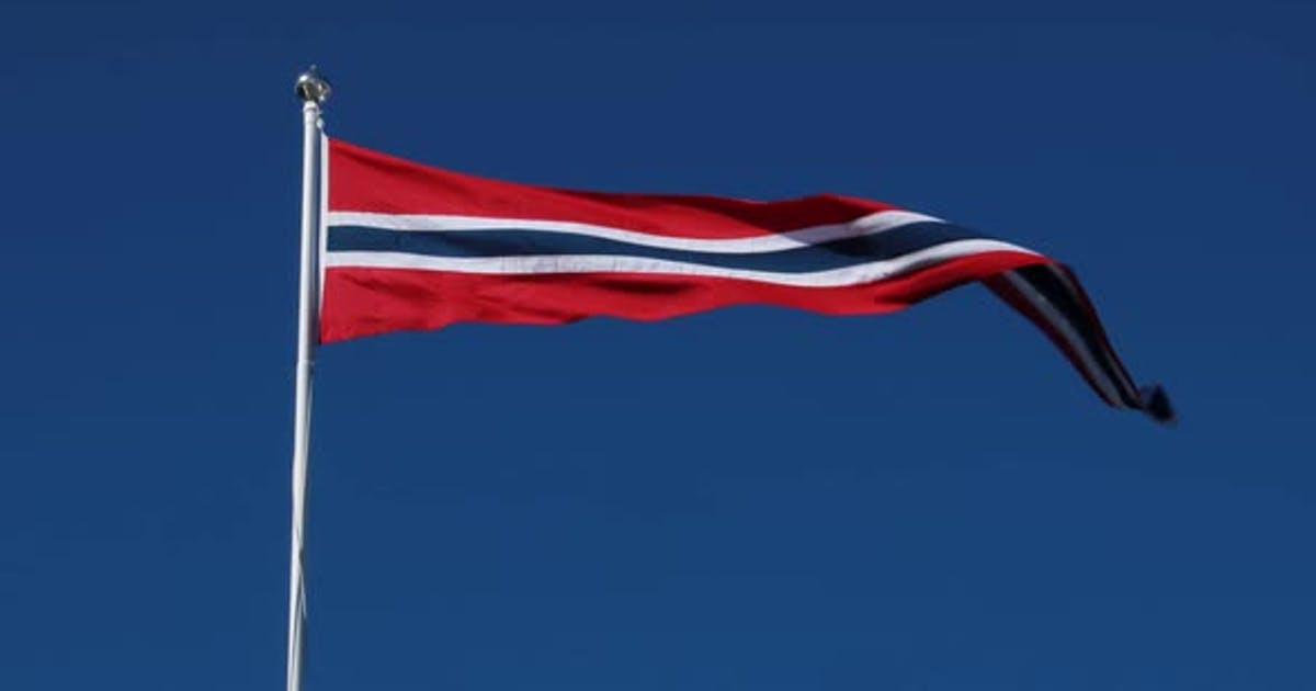 Norway Pennant Flag Waving in the Wind Against Deep Blue Sky.