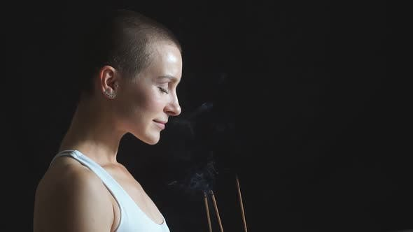 Attractive Female Meditating on Black Background in White Topic