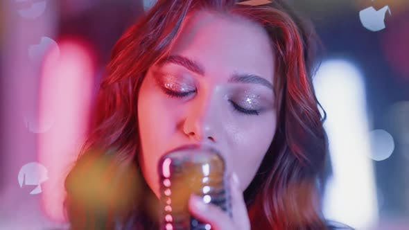 Portrait of a Young Female Singing in a Nightclub Party Closeup of a Woman's Face in Neon Light