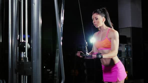 Thumbnail for Athletic Woman Practicing on the Simulator in the Gym.