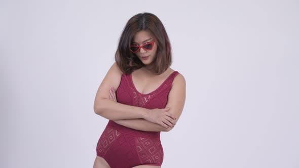 Thumbnail for Young Beautiful Asian Tourist Woman Peeking Over Sunglasses