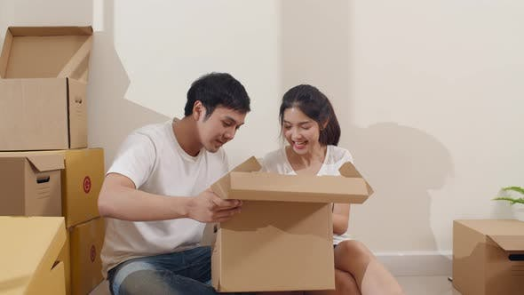 Korean family opening unpacking cardboard boxes and easy and fast service commerce delivery