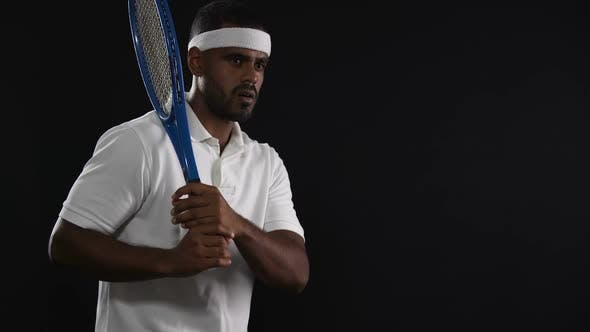Cover Image for Tired Hispanic Tennis Player Preparing to Strike a Ball, Active Lifestyle, Sport