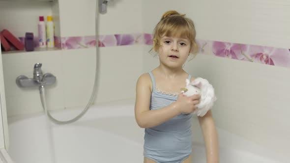 Thumbnail for Cute Blonde Girl Takes a Bath in Swimwear. Little Child, 4 Years Old. Hygiene