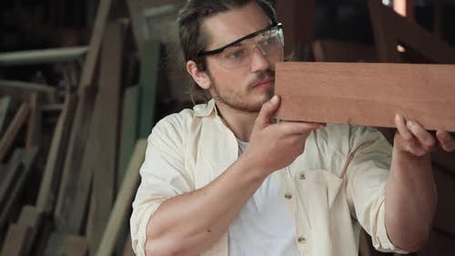 Man checking accurate of wood