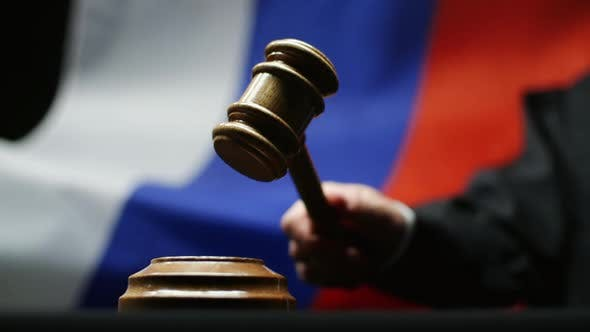 Thumbnail for Judge With Gavel In His Hand Against Waving Russian Flag in Courtroom