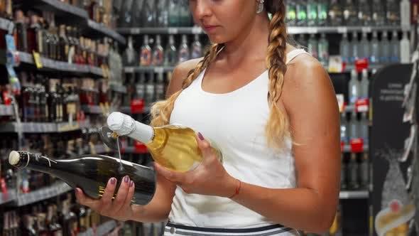 Thumbnail for Female Customer Choosing Between Two Bottles of Wine