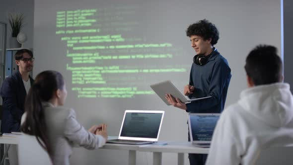 IT Student Answering At Blackboard With Laptop