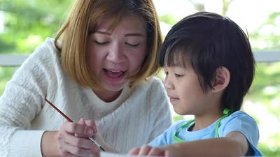 Cute Asian Child And Mother Painting Together