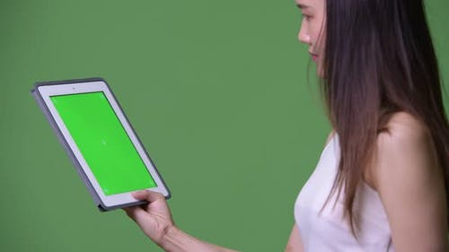 Young Beautiful Asian Businesswoman Showing Digital Tablet