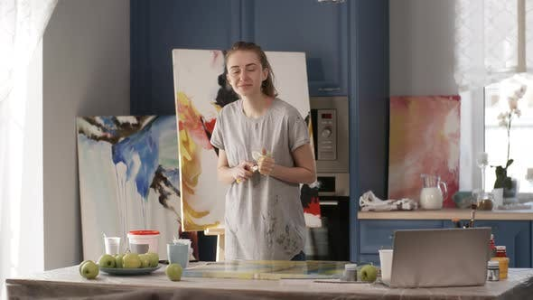 Thumbnail for Female Painter Smiling and Looking at Camera in Home Studio