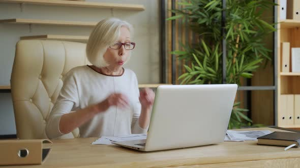 Thumbnail for Elderly Woman Winning on Computer Online. Overjoyed Old Woman Feels Euphoric Winner Celebrate
