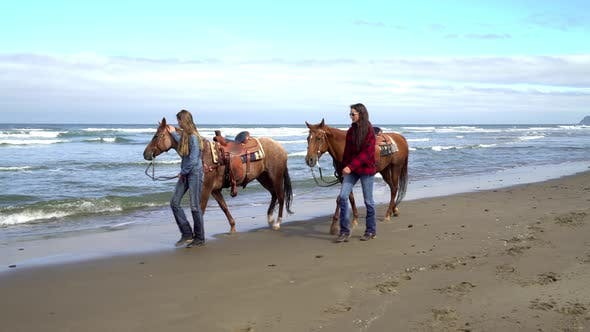 Thumbnail for Women walking with horses at beach