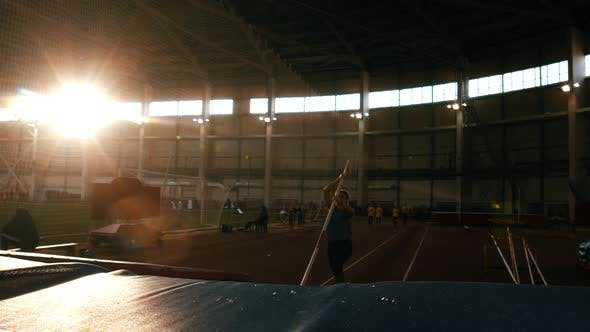 Thumbnail for Pole Vaulting - Young and Beautiful Athlete in Gray t Shirt Is Running and Jumping Over the Bar
