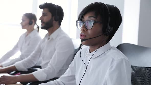 People Work At Contact Center. Woman In Headset Working