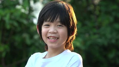 Happy Asian Child Smiling Outdoor