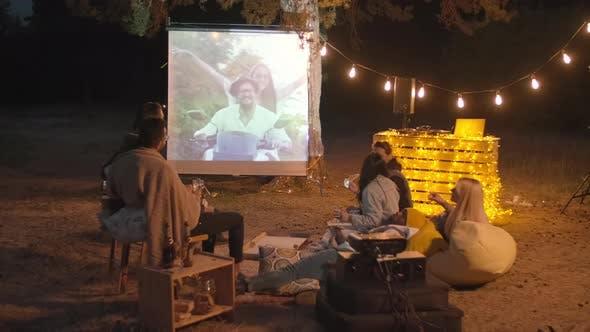 People Watching Movie At Open Air Cinema