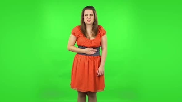 Thumbnail for Cute Girl Is Feeling Very Bad, Her Stomach Hurting . Green Screen