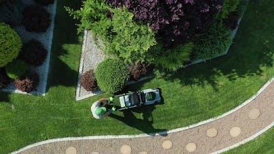 Garden Grass Mowing by Gardener